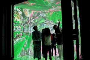 Visitors explore the 10 foot canvas in the discovery building that became Wonder