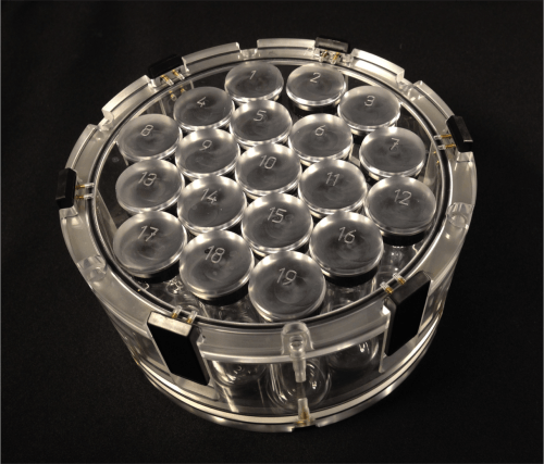Close up photo of Calimetrix's device, a circular column filled with numbered circles inside from 1-19.